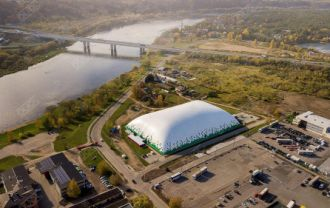 Beautiful football air dome in Kaunas. Aerial drone footage.